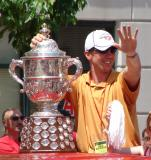 Dallas Drake waves to the crowd while holding the Campbell Bowl during the 2008 Stanley Cup parade.