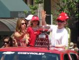 Chris Osgood waves to the crowd while travelling with the Jennings Trophy in the 2008 Stanley Cup parade.
