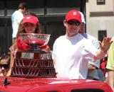 Chris Osgood waves to fans while holding the Jennings Trophy during the 2008 Stanley Cup parade.