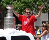Nicklas Lidstrom waves to the crowd while holding the Stanley Cup during the 2008 Stanley Cup parade.