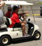 Chris Chelios returns to Joe Louis Arena from Hart Plaza in a golf cart with the Stanley Cup.