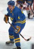 Nicklas Lidstrom skates backawards through a faceoff circle while playing for Team Sweden in the 1998 Olympic Winter Games.