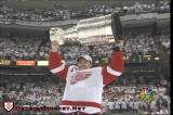 Nicklas Lidstrom raises the Stanley Cup after accepting it from NHL Commissioner Gary Bettman.