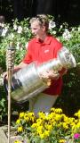Justin Abdelkader carries the Stanley Cup across the back yard of his parents' house at the private party during his day with the Cup.