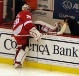 Ty Conklin stretches at the bench during pre-game warmups.