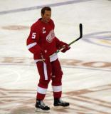 Nicklas Lidstrom stands at center ice during pre-game warmups.