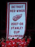 The Red Wings pose in front of the banner commemorating their 2008 Stanley Cup Championship.
