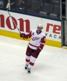 Niklas Kronwall raises his stick to the crowd after being named one of the stars of the game.