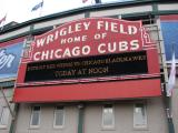 The Wrigley Field scoreboard displays the matchup of the Winter Classic.