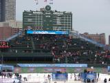 A wide-angle view of the Wrigley Field bleachers, including the iconic scoreboard, prior to the Winter Classic.