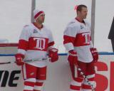 Brian Rafalski and Dan Cleary stand along the boards during pre-game warmups before the Winter Classic.