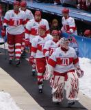 Ty Conklin leads Kris Draper, Kirk Maltby, Tomas Holmstrom, Andreas Lilja, Dan Cleary and Mikael Samuelsson out of the visitor's dugout at Wrigley Field prior to the Winter Classic.