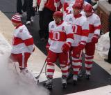 Chris Osgood, Henrik Zetterberg, Johan Franzen and Niklas Kronwall walk to the rink at Wrigley Field prior to the Winter Classic.