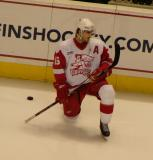 Ryan Oulahen stretches along the board during pre-game warmups for a Grand Rapids Griffins game.