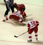 Justin Abdelkader takes a faceoff against Warren Peters with Mattias Ritola on his wing in a Grand Rapids Griffins game against the Quad City Flames.