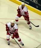 Justin Abdelkader and Ville Leino cover the corner in a Grand Rapids Griffins game against the Quad City Flames.