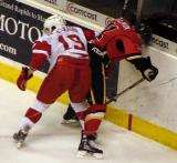 Justin Abdelkader pinches off Gord Baldwin along the boards in a Grand Rapids Griffins game against the Quad City Flames.