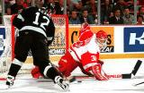 Chris Osgood sprawls out across the crease to make a stop on Dallas' Mike Keane.
