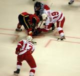 Justin Abdelkader takes a faceoff against Warren Peters with Jan Mursak on his wing in a Grand Rapids Griffins game against the Quad City Flames.