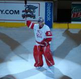 Daniel Larsson waves to the crowd after being announced as the first star of a Grand Rapids Griffins game against the Quad City Flames.