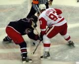 Johan Franzen takes a faceoff against Antoine Vermette of the Columbus Blue Jackets.