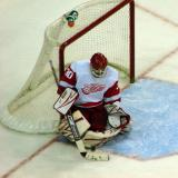 Chris Osgood drops to his knees to make a stop.