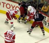 Henrik Zetterberg and Nicklas Lidstrom battle Rick Nash and Kristian Huselius of the Columbus Blue Jackets for the puck, with Brian Rafalski providing support.