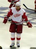 Tomas Kopecky stands in the neutral zone during pre-game warmups.