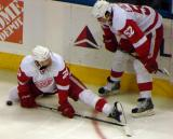 Brad Stuart and Jonathan Ericsson stretch along the boards during pre-game warmups.