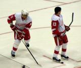 Marian Hossa skates past Pavel Datsyuk during pre-game warmups.