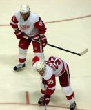 Marian Hossa and Niklas Kronwall line up for a defensive-zone faceoff.