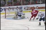 Henrik Zetteberg takes a slap-pass from Nicklas Lidstrom to break in and beat Nashville's Pekka Rinne.