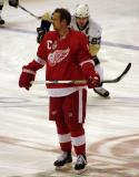 Nicklas Lidstrom stands at center ice during pre-game warmups as Pittsburgh captain Sidney Crosby skates behind him.