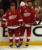 Jiri Hudler and Dan Cleary stand along the boards during pre-game warmups.