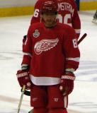 Marian Hossa stands near center ice during pre-game warmups.