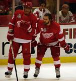 Marian Hossa and Henrik Zetterberg stand near the boards during pre-game warmups.