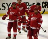 Niklas Kronwall and Johan Franzen stand inside the blue line with Justin Abdelkader and Pavel Datsyuk skating behind them during pre-game warmups.
