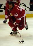 Henrik Zetterberg charges off the boards with the puck during pre-game warmups.