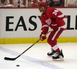 Chris Chelios moves the puck at the blue line during pre-game warmups.