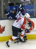 Toronto's Kris Newbury is run into the boards by Florida's Ruslan Salei.