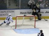 Toronto's Kris Newbury chases after goaltender Mike Smith behind the Tampa Bay goal.