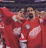 Darren McCarty and Brendan Shanahan each raise two fingers to symbolize the Red Wings' back-to-back Stanley Cup championships.