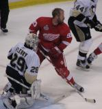 Johan Franzen goes to the net even without his helmet.