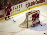 Brian Rafalski sets up behind Jimmy Howard during a preseason game against the Buffalo Sabres.