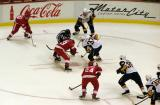 Francis Lemieux, flanked by Jeremy Williams and John Vigilante, takes a faceoff against former Red Wing Matt Ellis, Tyler Myers, Patrick Kaleta and Nathan Paetsch, in a preseason game against the Buffalo Sabres.