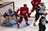 Tomas Holmstrom sets up in front of Ryan Miller's crease, peeking around defensemen Toni Lydman and Mike Weber, in a preseason game against the Buffalo Sabres.