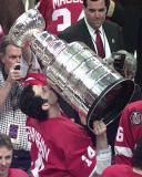 Brendan Shanahan, surrounded by photographers, kisses the Stanley Cup after the 1998 Finals.