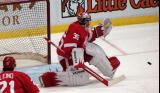 Jimmy Howard kicks out a pad during pre-game warmups.