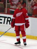 Drew Miller looks up at the scoreboard during pre-game warmups.