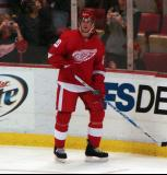 Drew Miller stands along the boards during pre-game warmups.